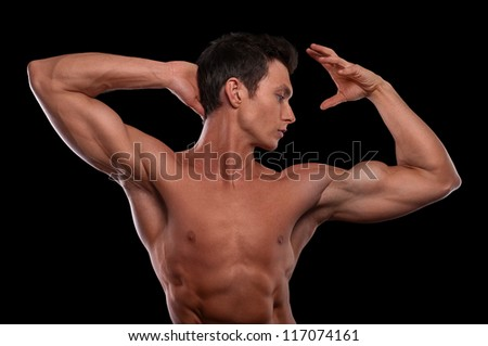 Portrait of young male fitness model posing