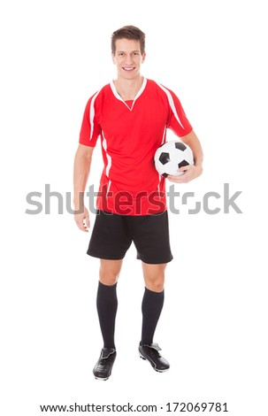 Portrait Of Young Male Soccer Player Holding Football - stock photo