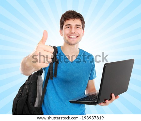 portrait of Young male student with laptop showing thumb up isolated over white background - stock photo
