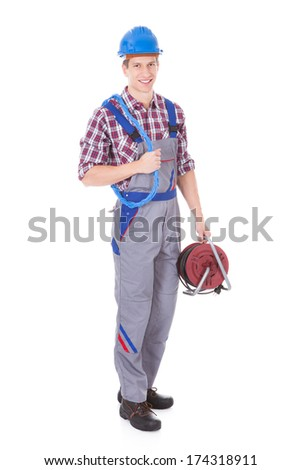 Portrait Of Young Male Technician Standing With Equipments - stock photo