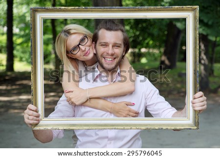 Portrait of young man and woman - stock photo