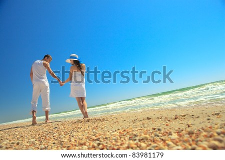 Portrait of young man and woman enjoying a summer vacation. - stock photo