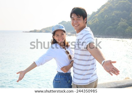 portrait of young man and woman relaxing and happy emotion on sea side use for people relax and feel free on vacation go to beautiful nature destination - stock photo