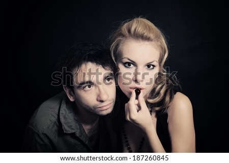 Portrait of Young man and woman with chocolate candies - stock photo