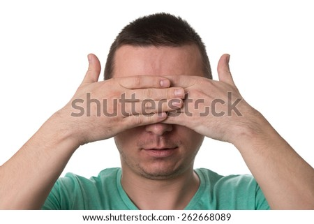 Portrait Of Young Man Covering With Hand His Eyes - Isolated On White Background - stock photo
