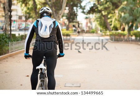 Portrait Of Young Man Cycling; Outdoors - stock photo