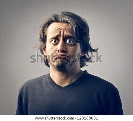 portrait of young man disappointed - stock photo