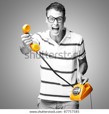 portrait of young man giving a vintage telephone, black and white image