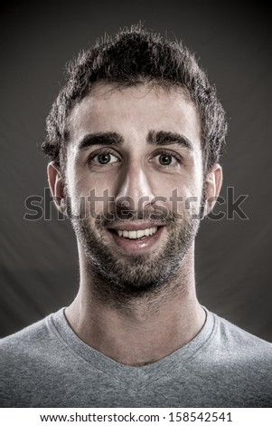Portrait of young man happy - stock photo