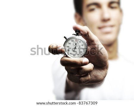portrait of young man holding a vintage stopwatch against a white background - stock photo