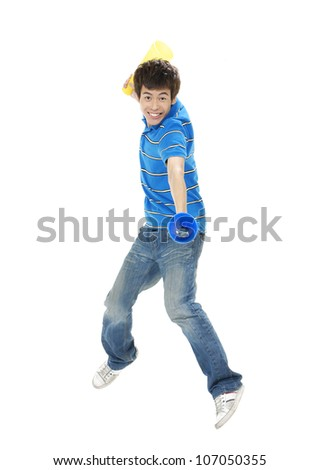 Portrait of young man holding announcement in jeans jumping