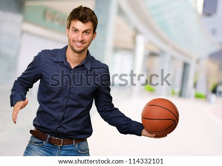 Portrait Of Young Man Holding Basketball, Outdoor