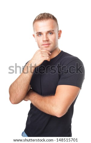 Portrait of young man holding hand up to chin with arms folded isolated on white background - stock photo