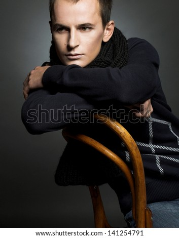 Portrait of young man in black scarf