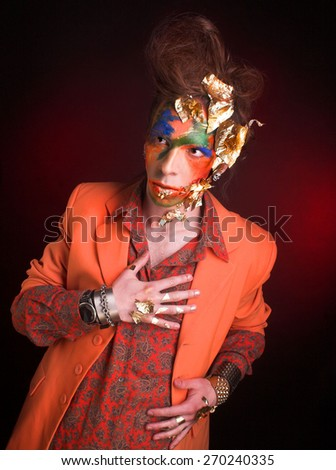 Portrait of young man in creative image with eccentric visage and in stylish cloth. - stock photo