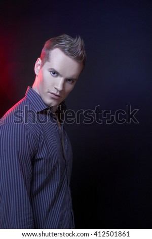 Portrait of young man in dark shirt