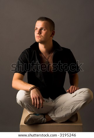 portrait of young man in jeans