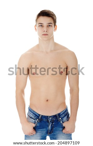 Portrait of young man in jeans with nude torso isolated on white background - stock photo