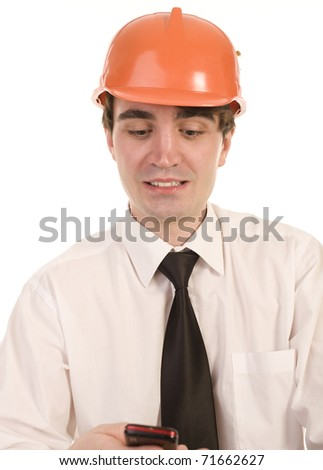 portrait of young man in  orange hard hat watching on his phone