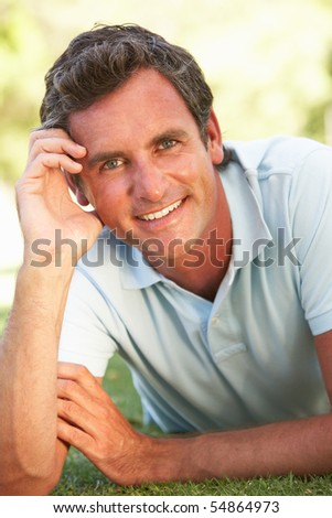 Portrait Of Young Man In Park - stock photo