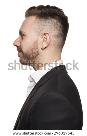 Portrait of young man in professional attire, studio setting - stock photo