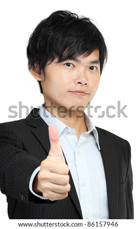 portrait of young man in suit and thumbs up - stock photo