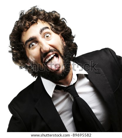 portrait of young man joking and showing the tongue over white background - stock photo