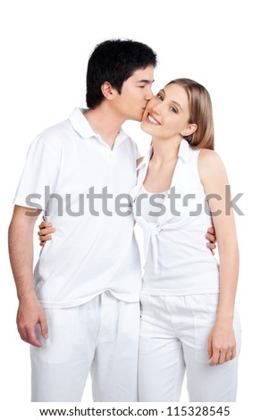 Portrait of young man kissing the young woman isolated on white background. - stock photo