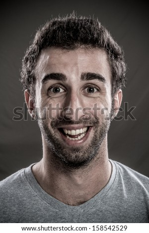 Portrait of Young Man laughing  - stock photo