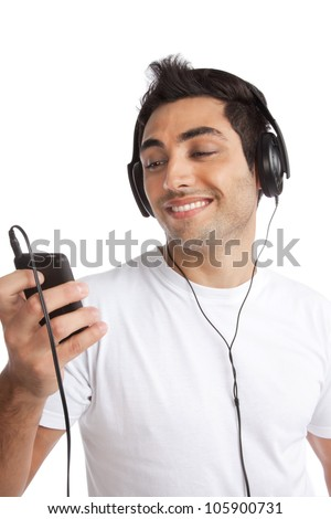 Portrait of young man listening music on smart cell phone isolated on white background. - stock photo