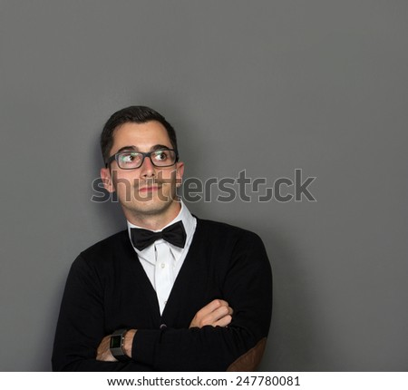 portrait of young man looking up to copy space - stock photo