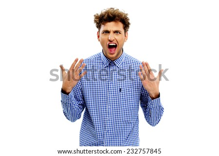 Portrait of young man looking very excited - stock photo