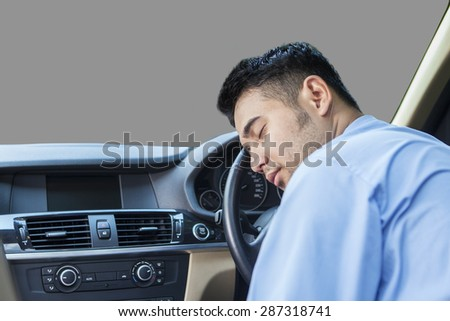Portrait of young man looks exhausted and sleep in the car while driving - stock photo