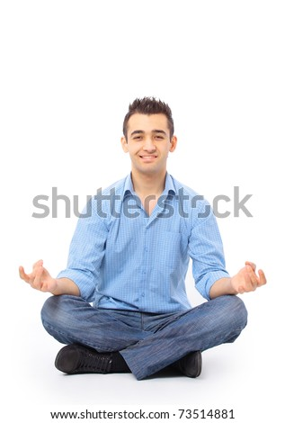 Portrait of young man meditating in a lotus position - stock photo