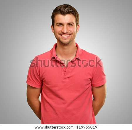 Portrait Of Young Man On Gray  Background