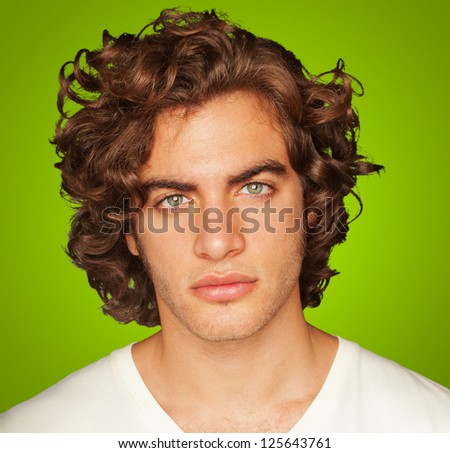 Portrait Of Young Man On Green Background - stock photo