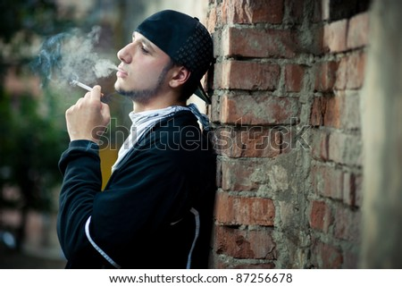 portrait of young man on street - stock photo