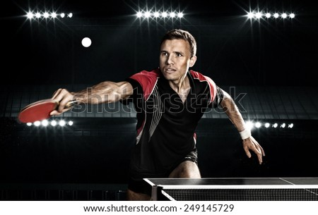 Portrait Of Young Man Playing Tennis On Black Background with lights - stock photo