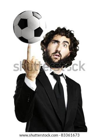 portrait of young man playing with a soccer ball - stock photo