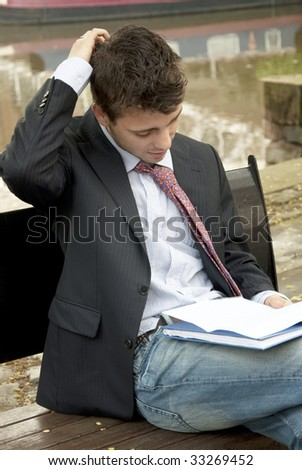 Portrait of young man reading a document