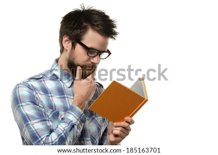 Portrait of young man reading isolated over white background - stock photo