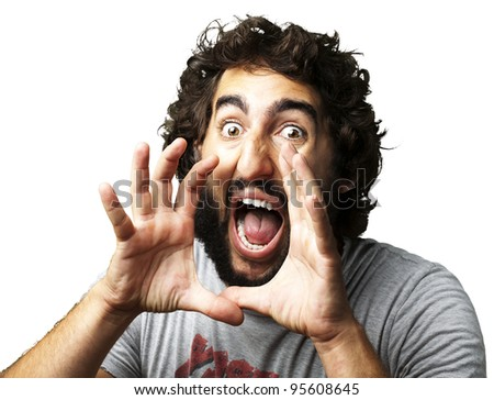 portrait of young man screaming against a white background - stock photo