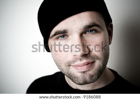 Portrait of young man - selective focus on the eyes. - stock photo