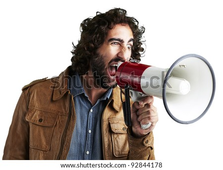 portrait of young man shouting with megaphone against a white background - stock photo
