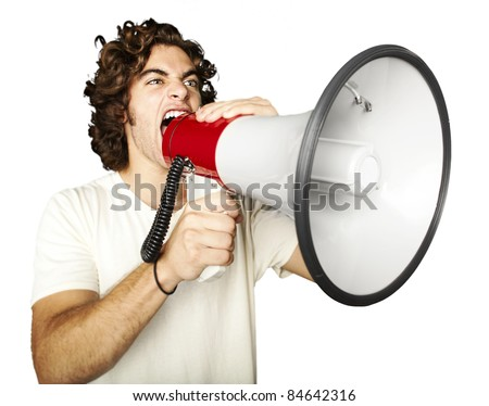portrait of young man shouting with megaphone over white background - stock photo