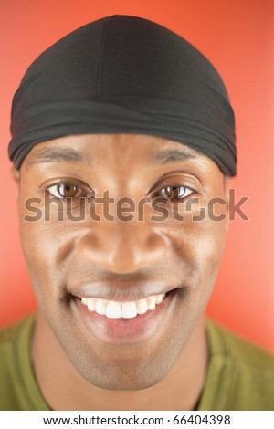 Portrait of young man smiling - stock photo