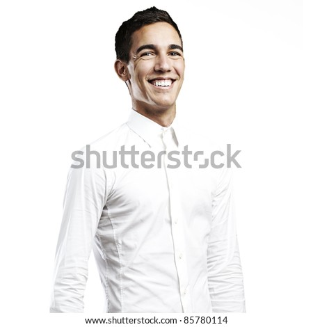 portrait of young man smiling against a white background - stock photo