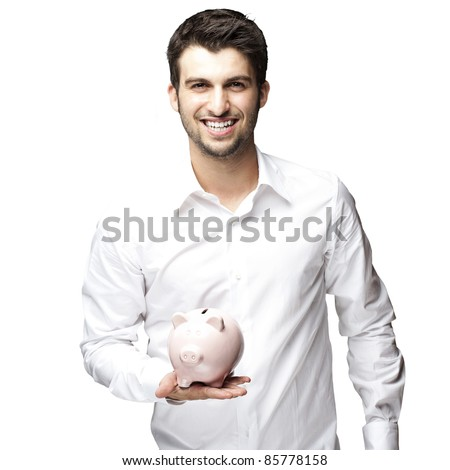 portrait of young man smiling and holding a piggy bank against a black background