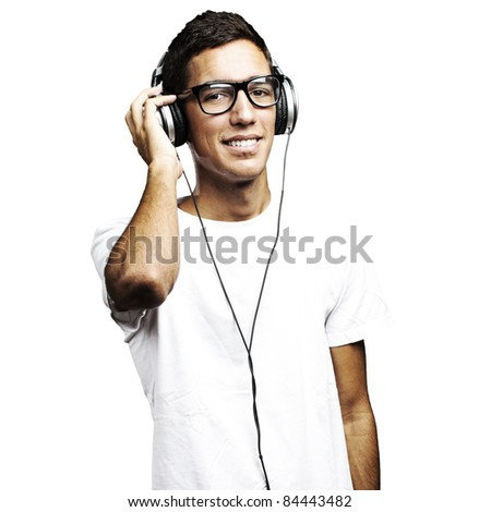 portrait of young man smiling and listening to music against a white background