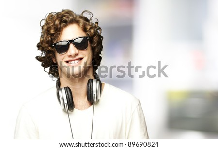 portrait of young man smiling with headphones indoor